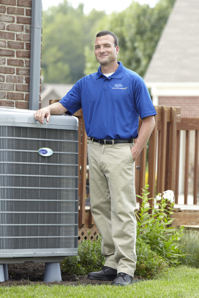 carrier dealer with ac unit outdoors
